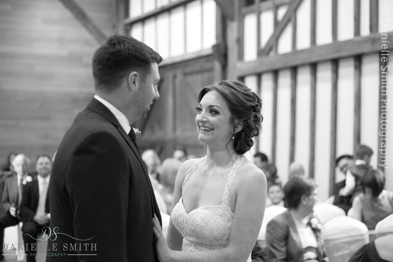bride and groom during ceremony - barn wedding in purfleet