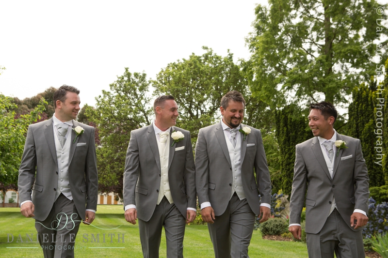 groomsmen walking in gardens at ye olde plough house