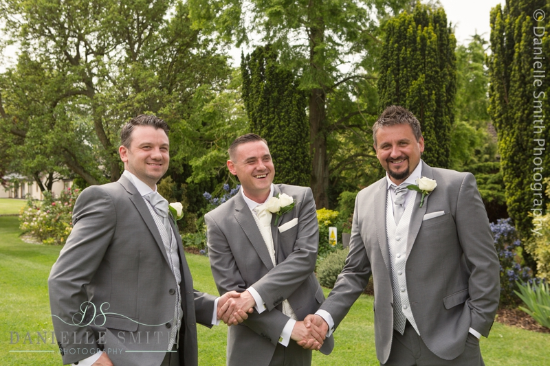 groom shaking best mens hands