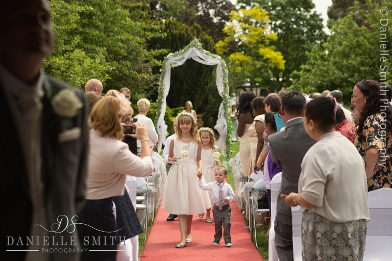 flower girl and page boy walking down aisle