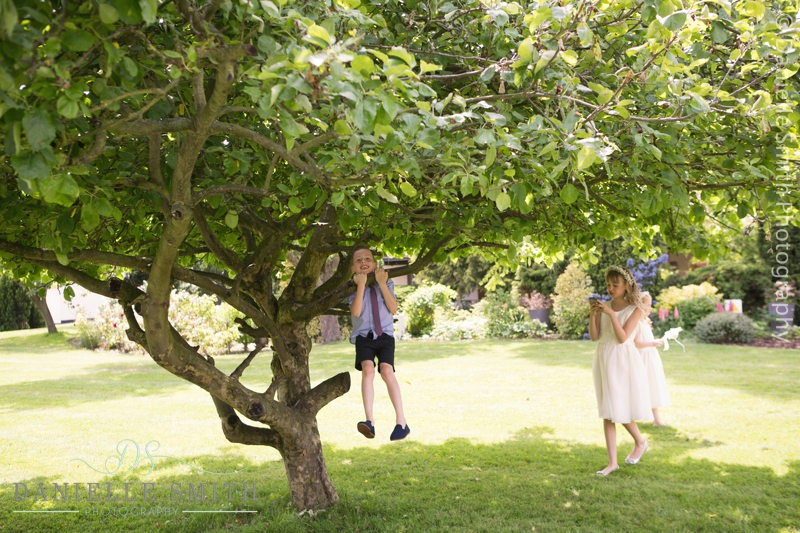 kids playing in gardens at wedding