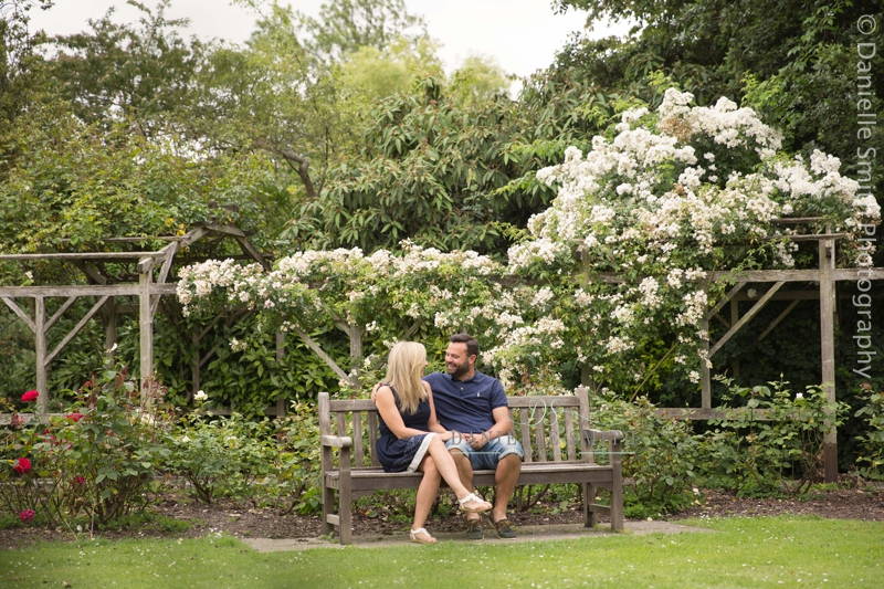 couple sitting on bench in spring - priory park southend photo shoot