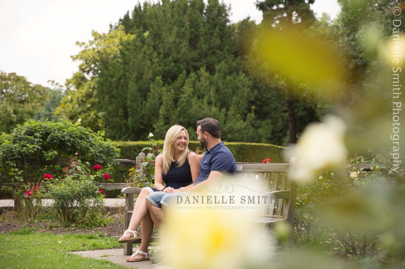 couple laughing on bench - pre-wedding photography southend