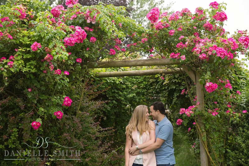couple with bright pink flower pergola