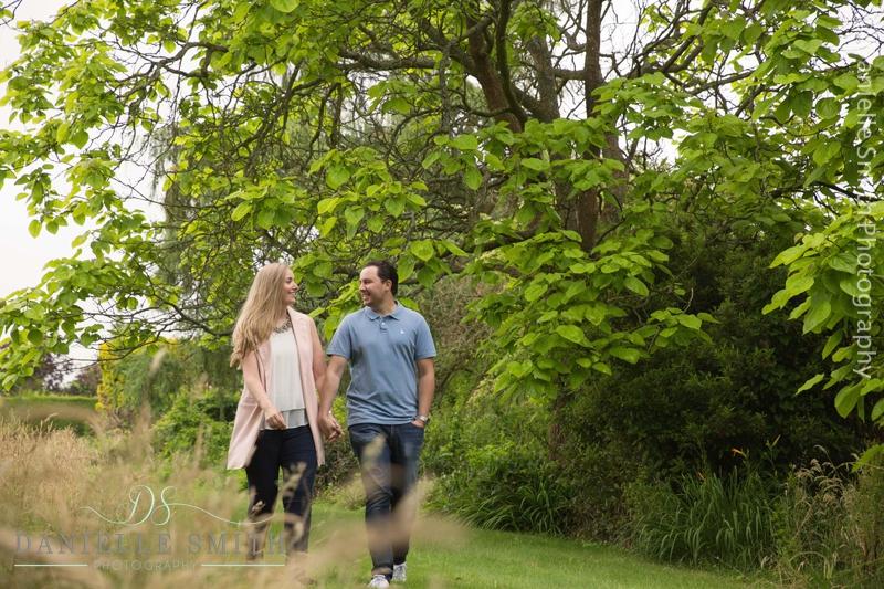 pre-wedding garden photo shoot - couple walking