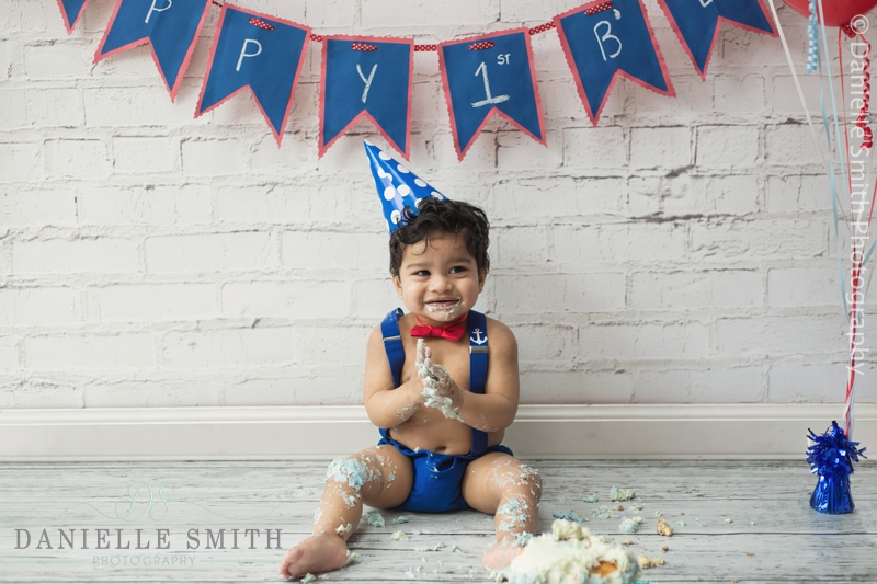 baby boy laughing during cake smash session