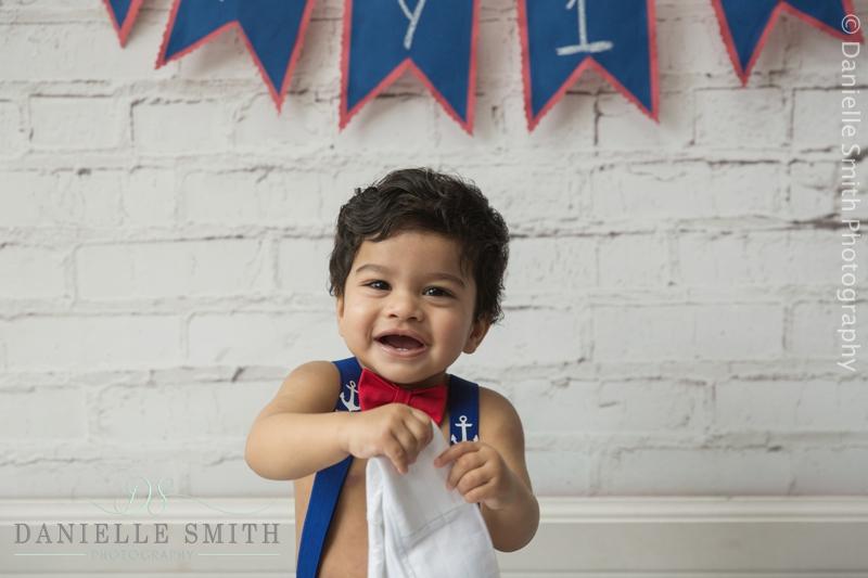 baby boy laughing - cake smash photographer basildon