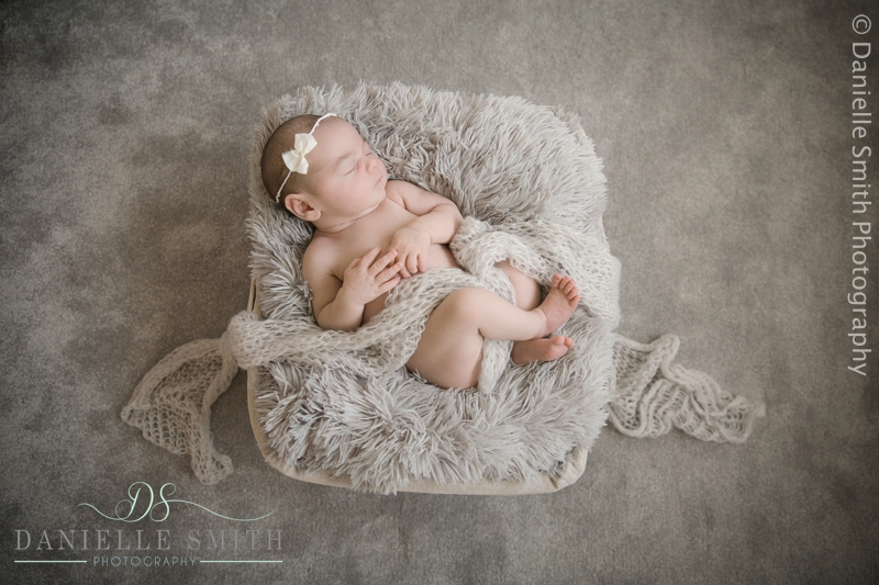 baby girl sleeping in basket