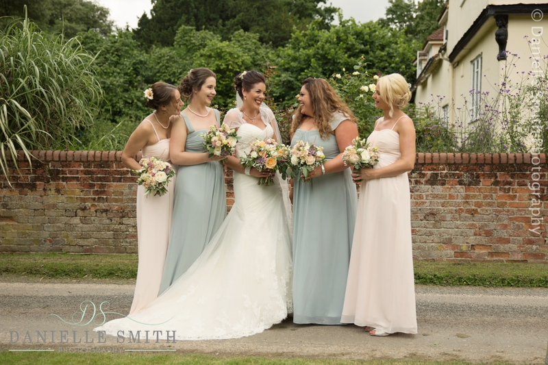 soft pink and green bridesmaids with bride