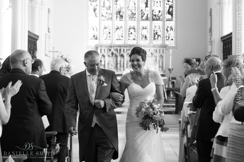 bride and groom walking down aisle - creative documentary wedding photography