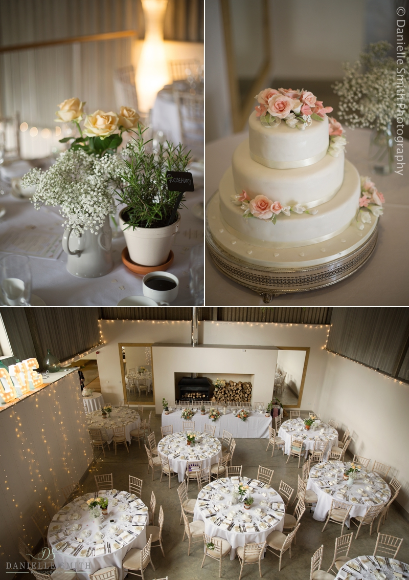 herb table decor and wedding cake