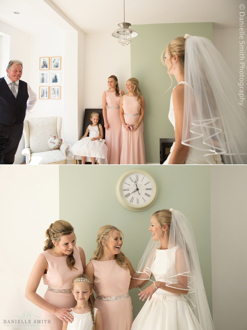 dad and bridesmaids seeing bride in her dress