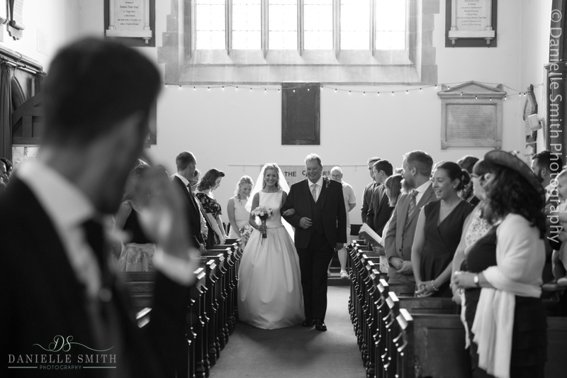 bride walking down aisle - havering-atte-bower church