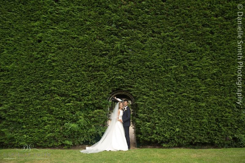 bride and groom in secret garden - old brook barn wedding