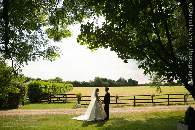 bride and groom with field in background - old brook barn wedding