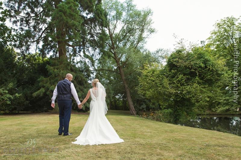 bride and groom walking away at summer wedding