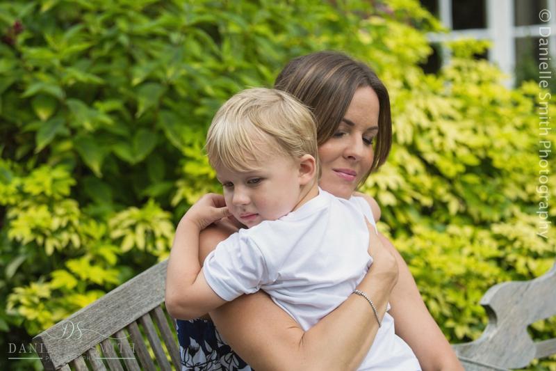 mum hugging her son at wedding