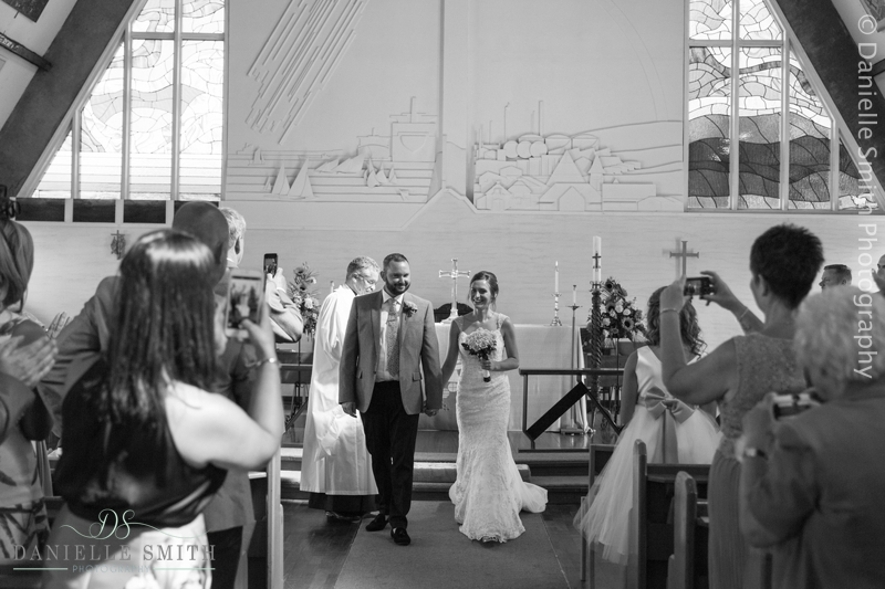 bride and groom walking down aisle in canvey