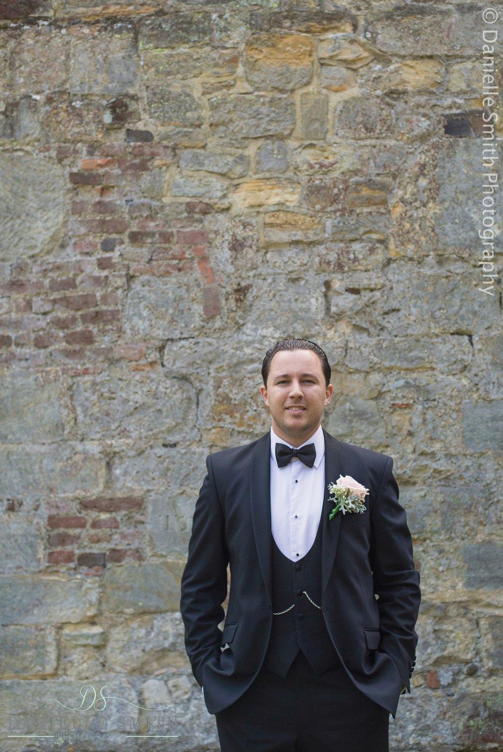 groom in 3 piece suit