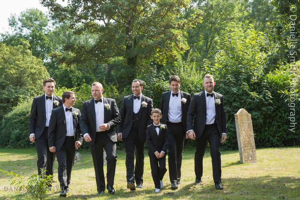 groom and groomsmen in church grounds