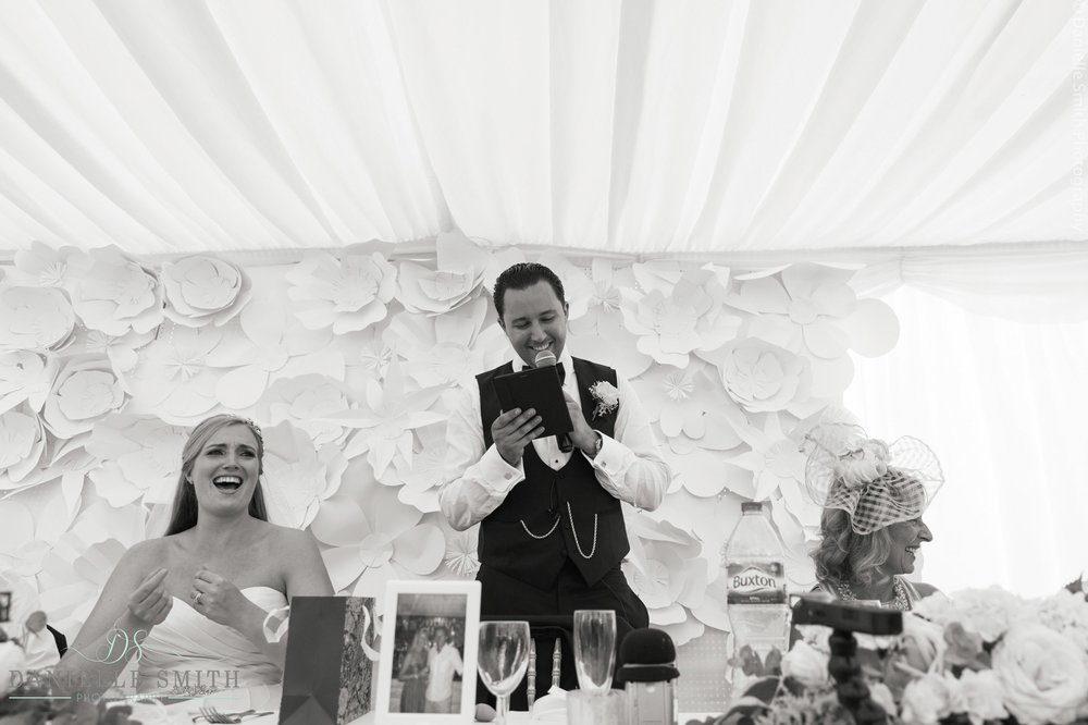 bride and groom laughing at speeches - summer garden wedding