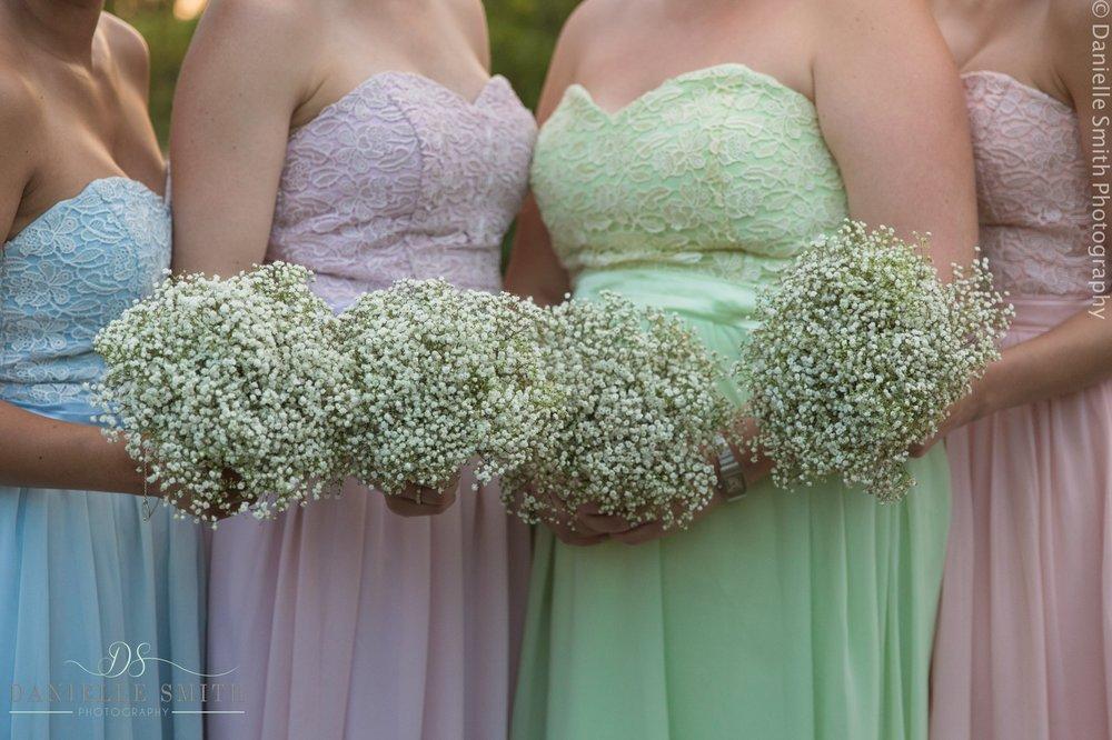 pastel bridesmaids dresses and babys breath bouquets