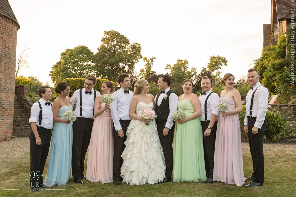 bridal party with colourful dresses - summer garden wedding