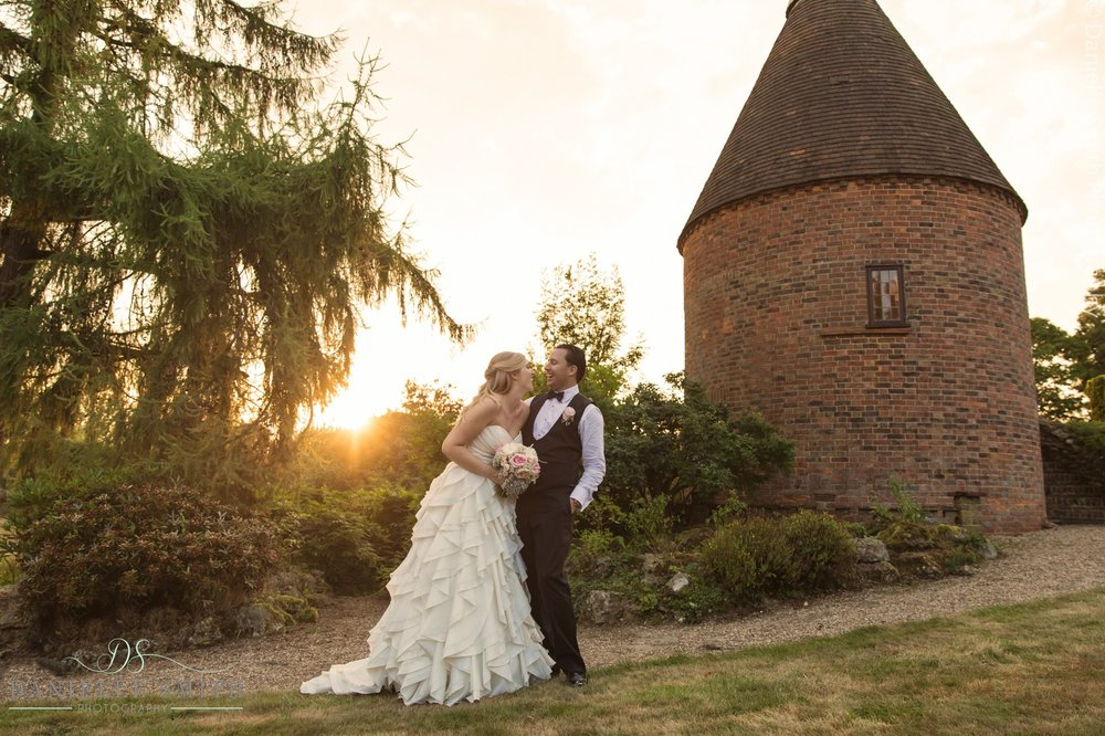 bride and groom laughing as sun goes down