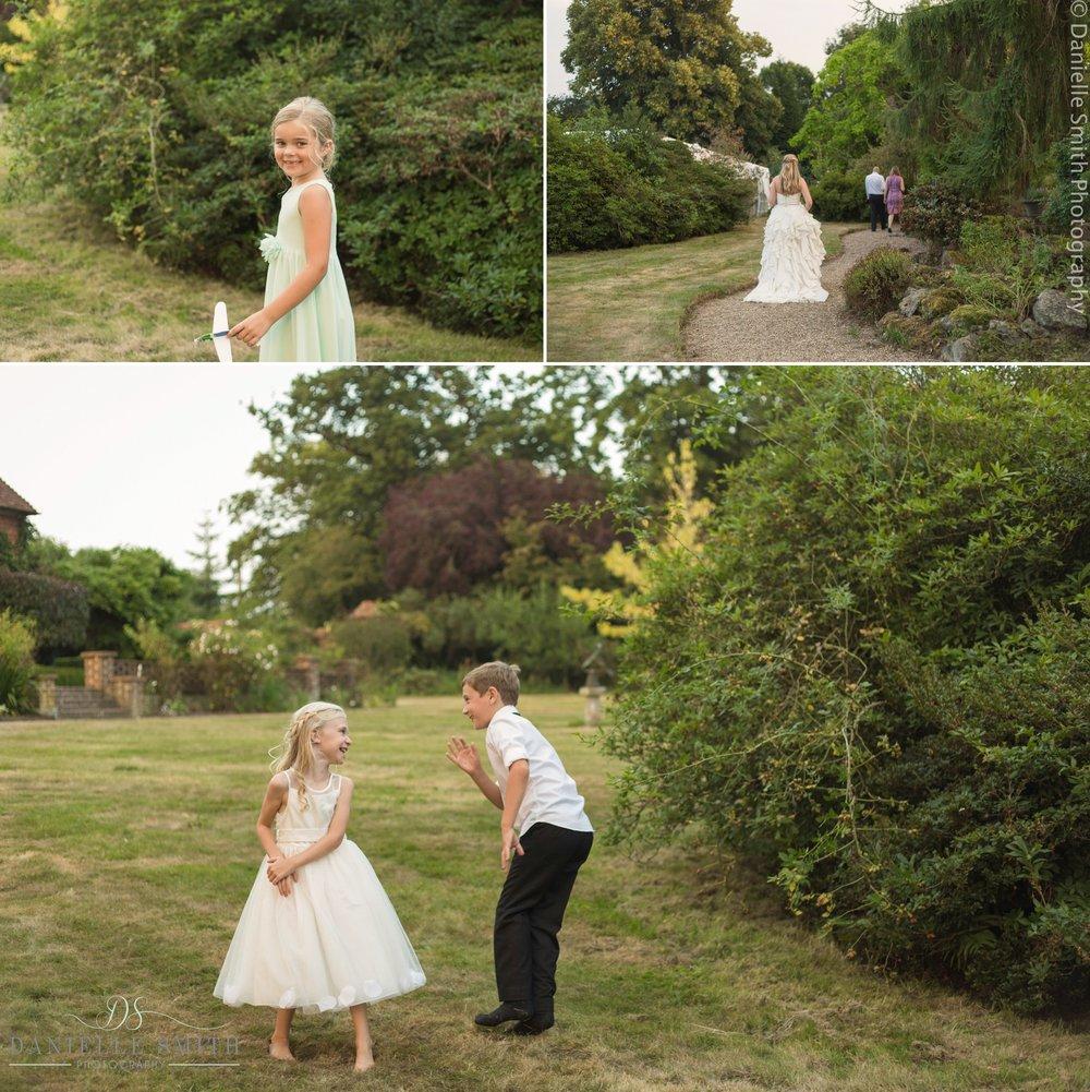 kids playing in gardens at summer wedding