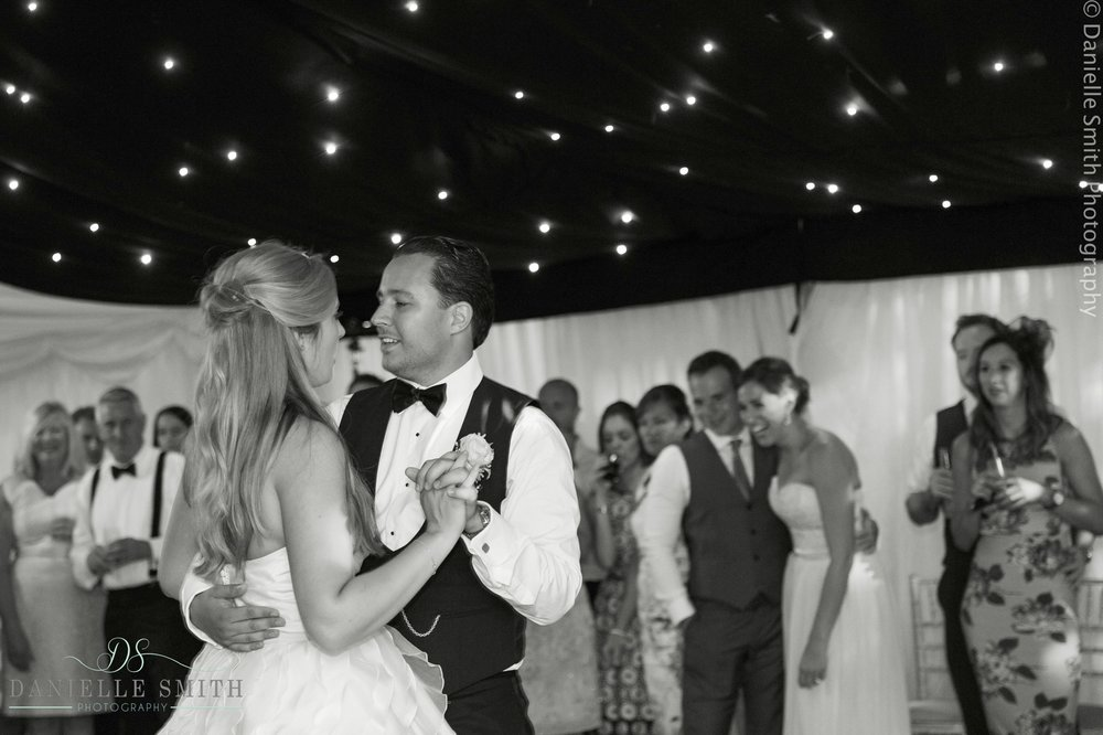 bride and groom first dance with twinkle lights