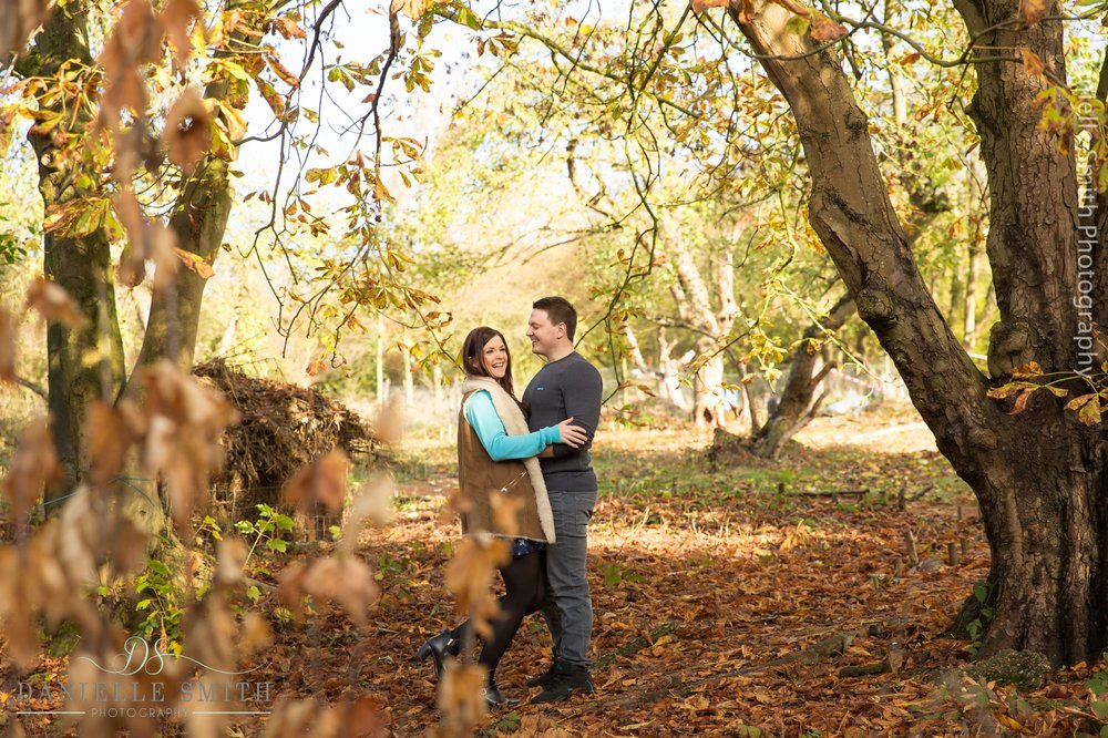 couple in autumn woodland