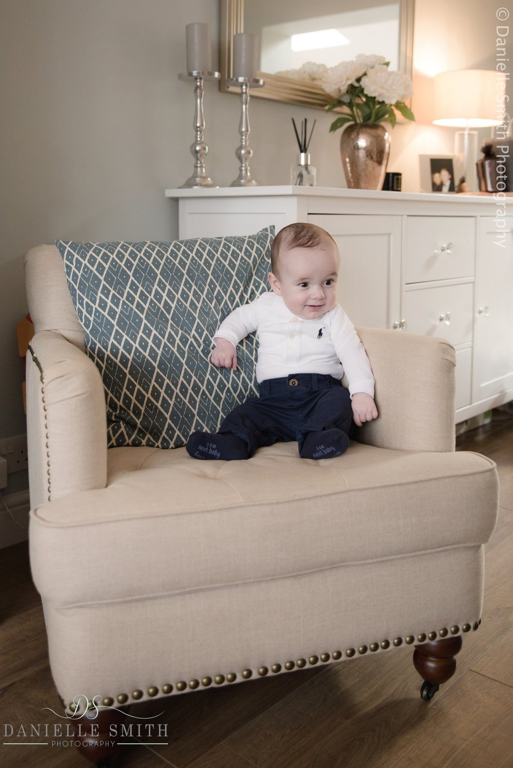 baby boy sitting on chair at home