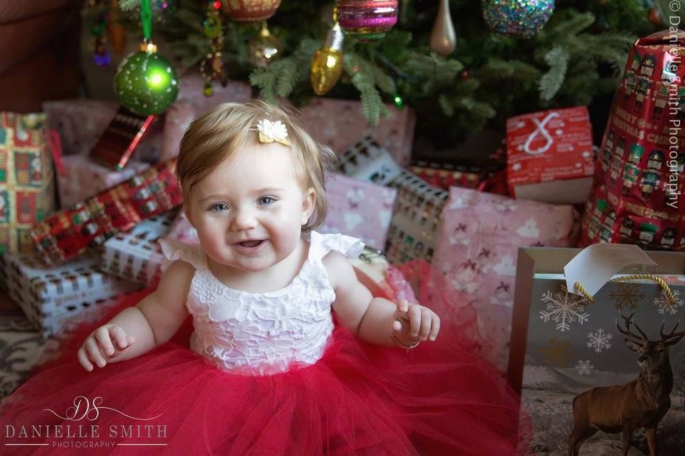little girl in red christmas dress