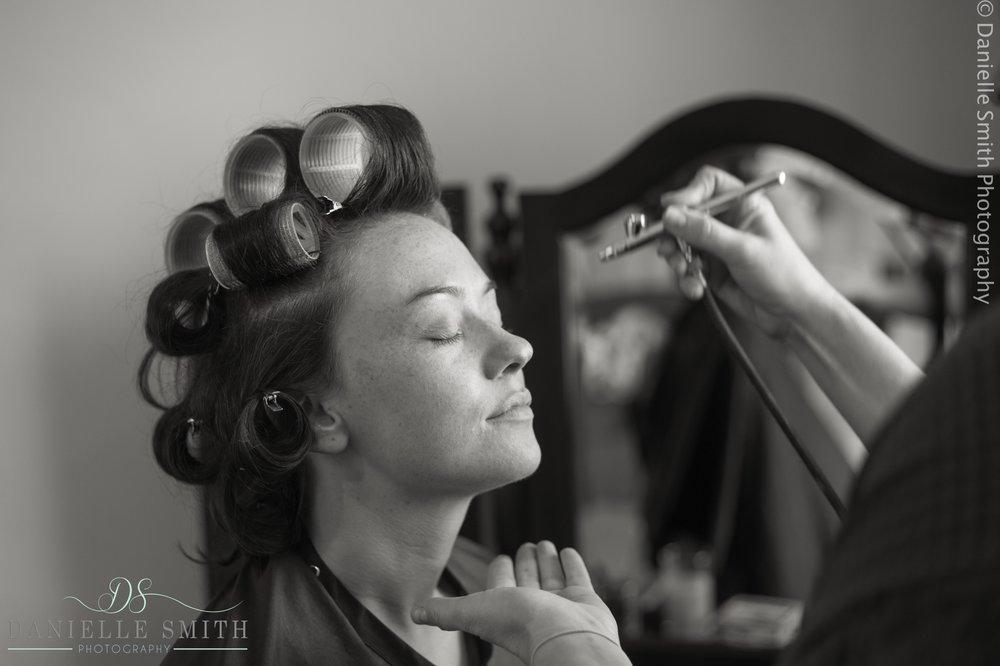 bride having airbrush make up
