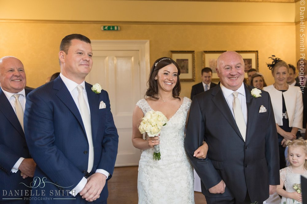 dad walking bride up aisle - fennes intimate wedding