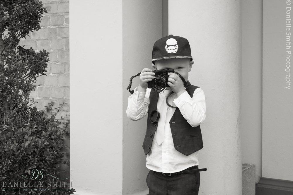 little boy taking photos