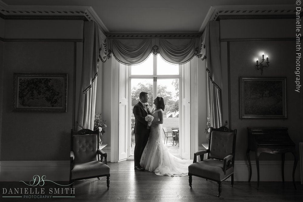 bride and groom in gold room - fennes intimate wedding
