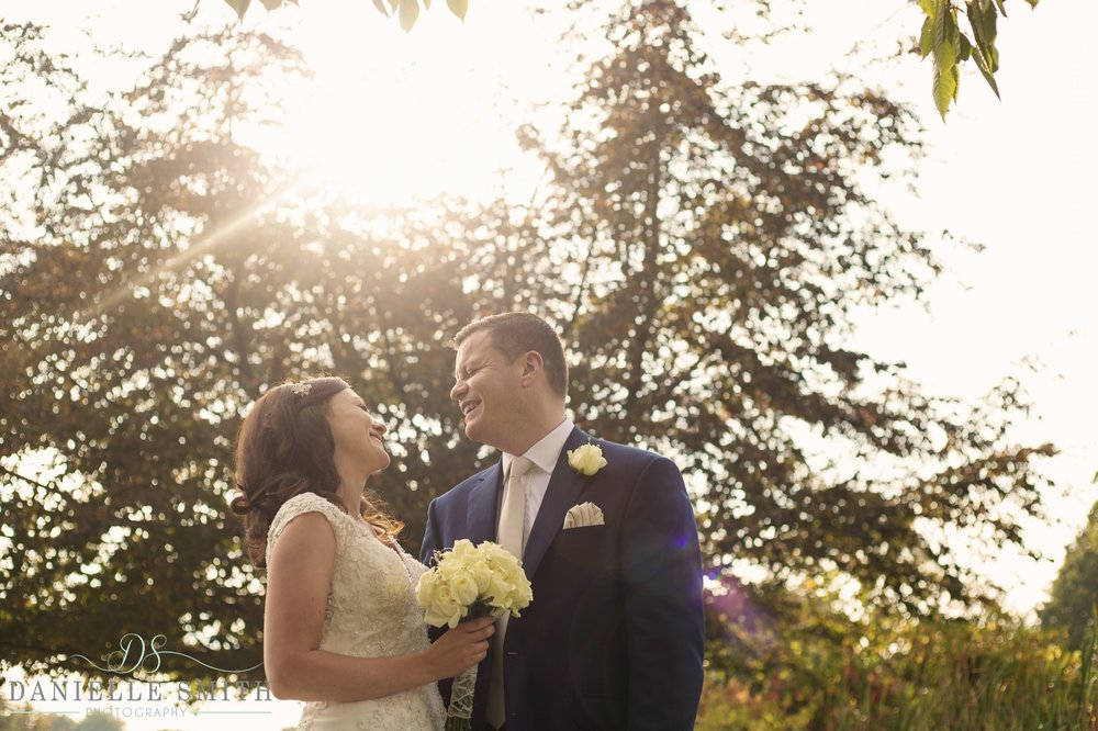 bride and groom laughing - fennes intimate wedding