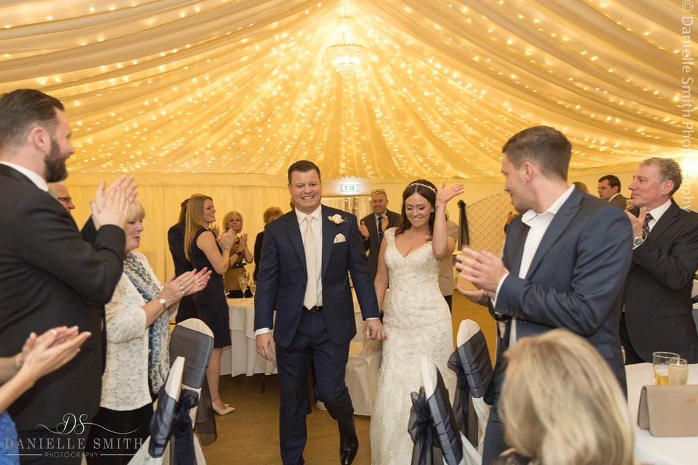 bride and groom enter reception room - fennes intimate wedding