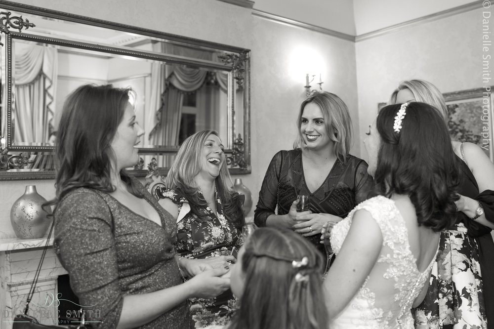 female wedding guests laughing