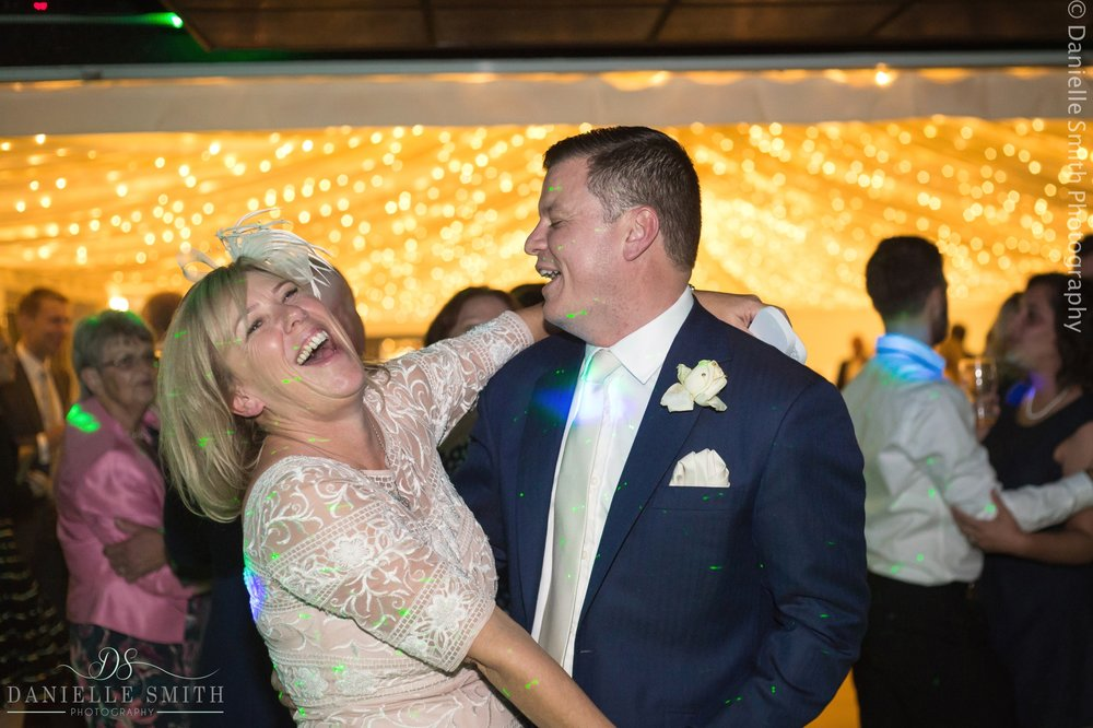 groom dancing with brides mum
