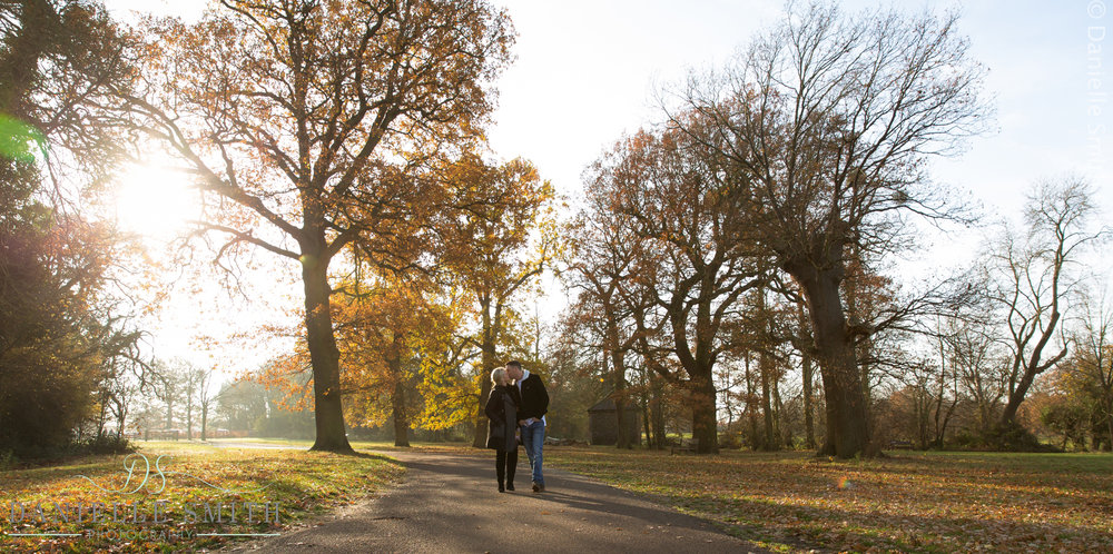 couple kissing in autumn park - family photography session chelmsford