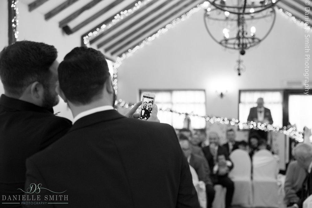 groom and best man having selfie