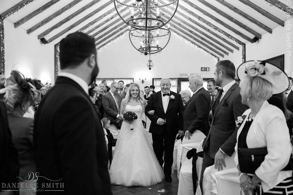 bride and her dad walking down aisle - new years eve wedding