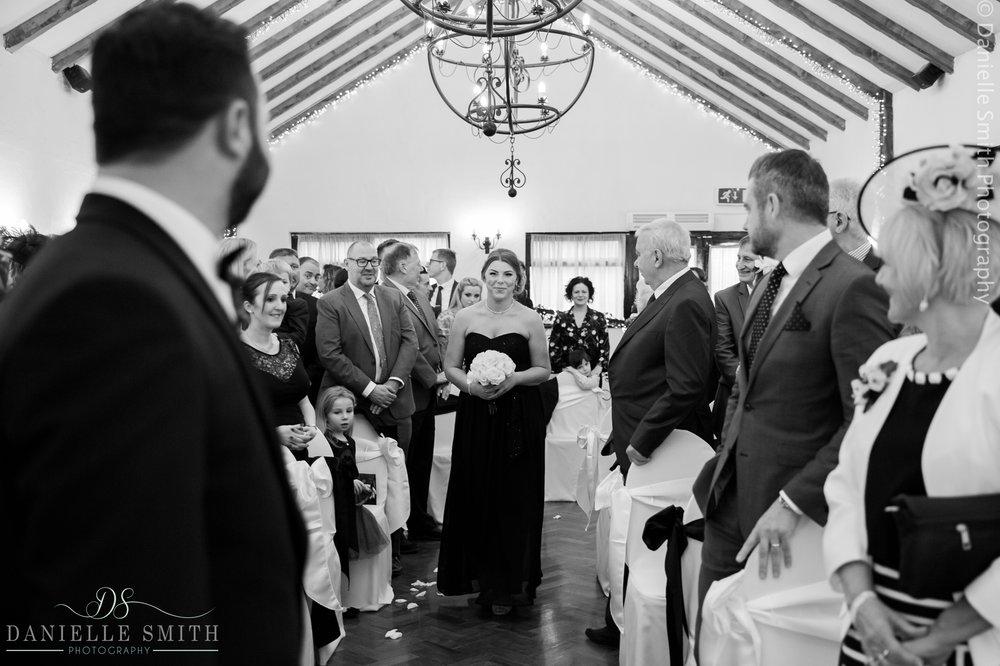 bridesmaids walking down aisle - crondon park wedding