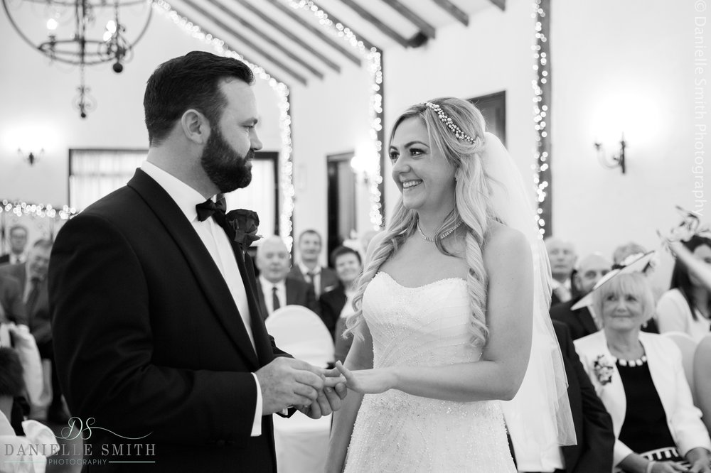 bride and groom exchanging rings at crondon park