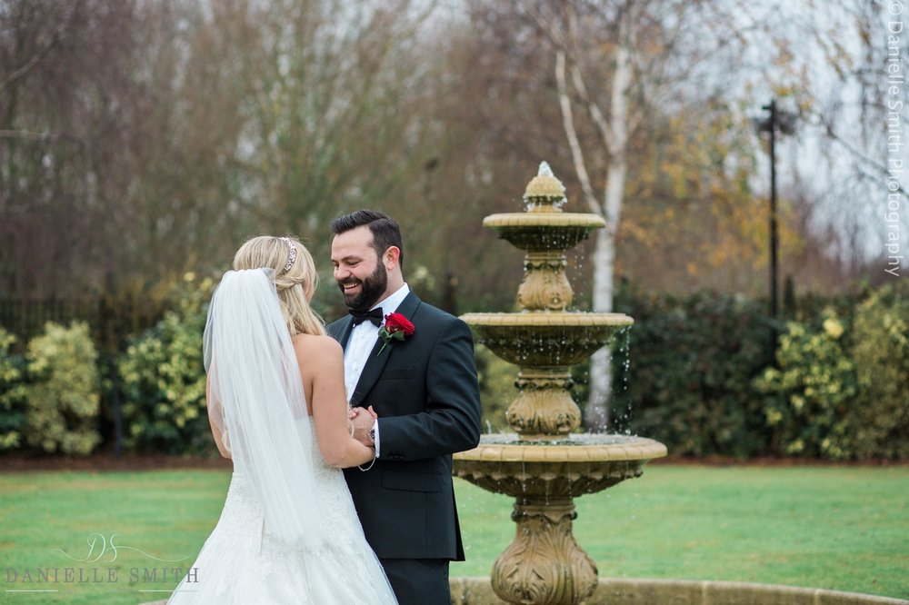 bride and groom by fountain at crondon park