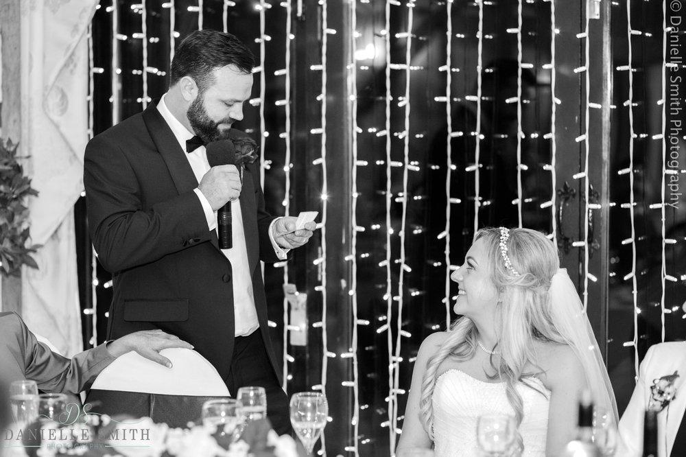groom giving speech to bride