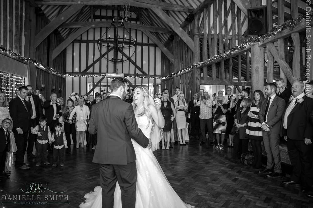 bride and groom laughing during first dance