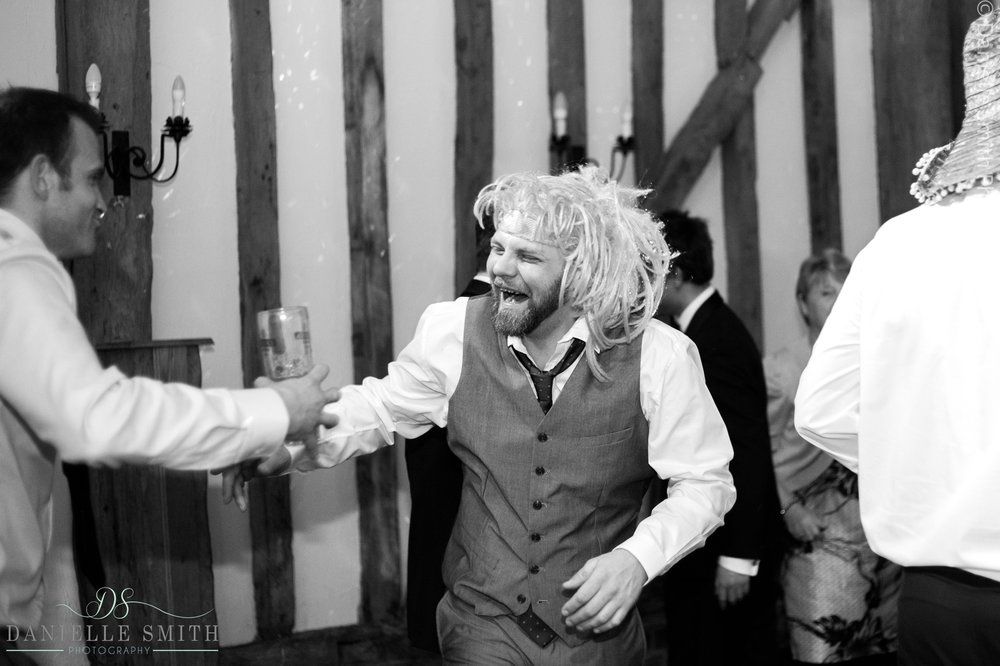 wedding guests with funny wig on